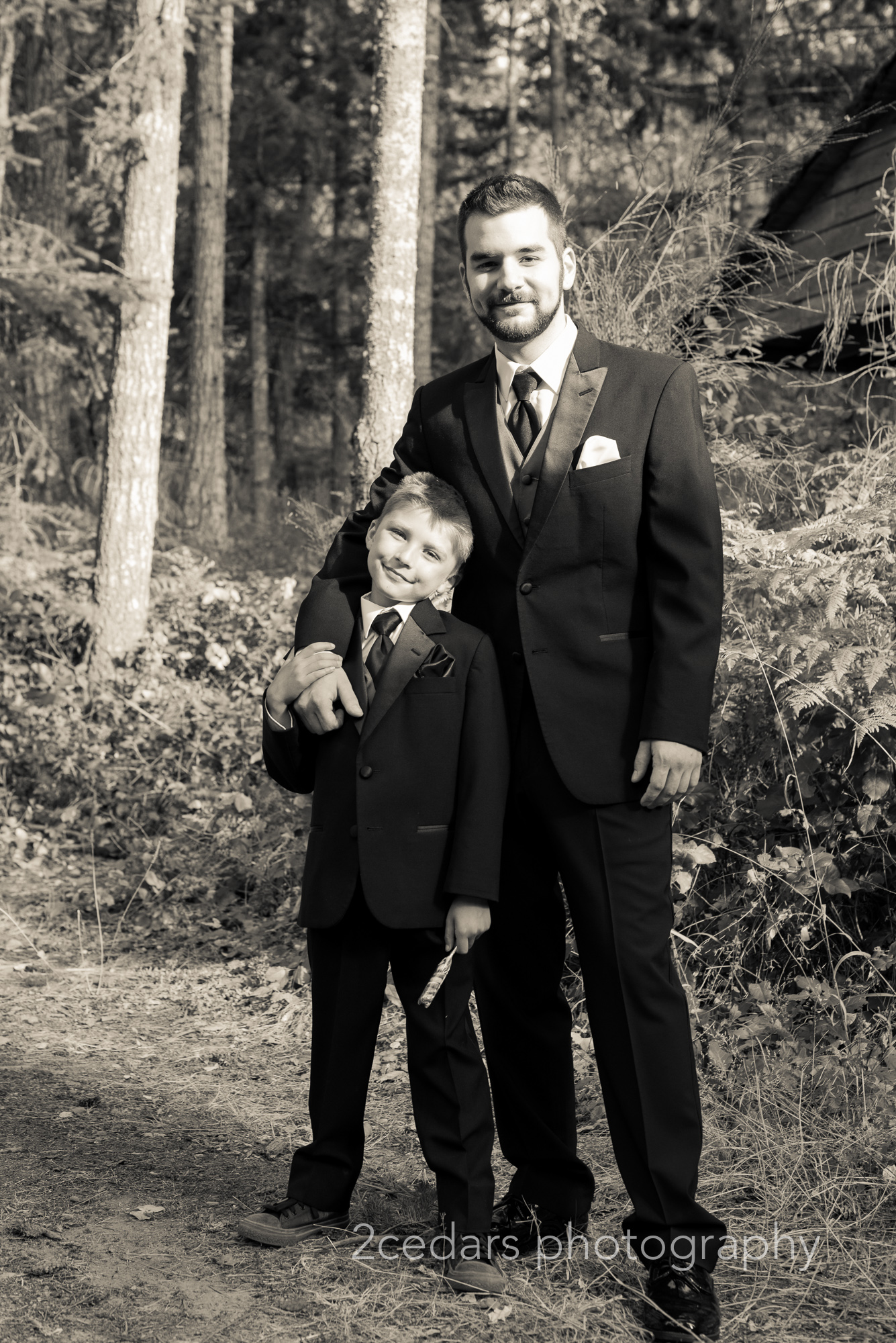 Black and White groom and son outdoor forest wedding