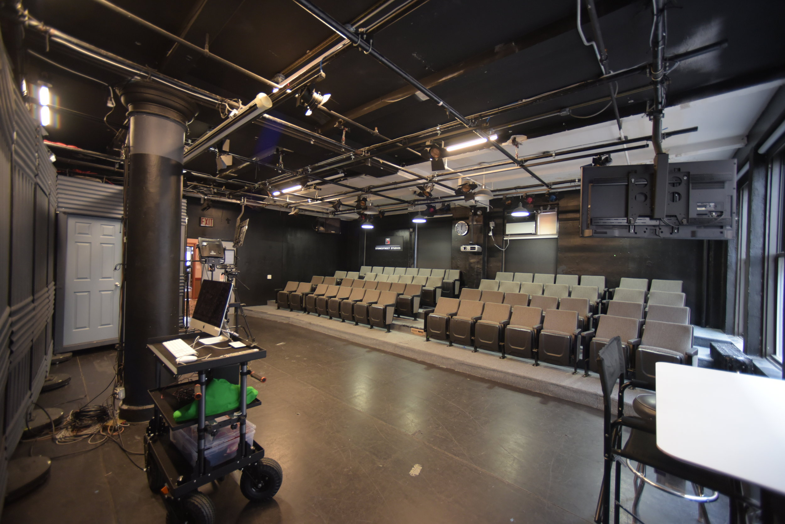 Studio 8-A - The Stonestreet Theater. Studio 8-A contains sixty raked seats facing a stage with dimensions of 16 ft by 30 ft. The ceiling is approximately 11.5 ft. high. The stage contains a full light grid and is controlled by a 48 dimmer board from the light booth. The stage can be viewed directly or by a video camera attached to the grid. Rental of Studio 8-A includes the use of the Engineering Room which contains the light board.