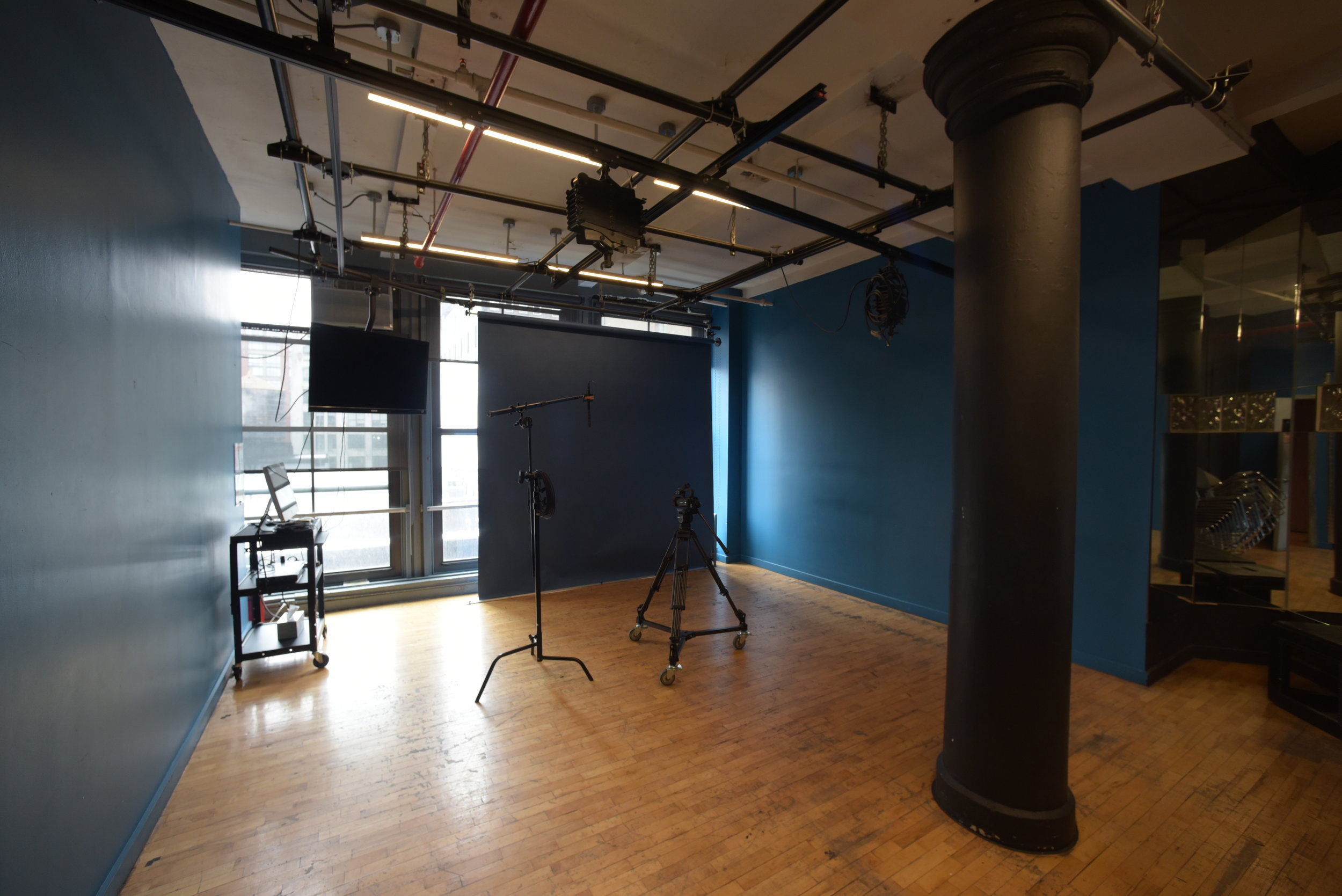 Studio 8-C. Studio 8-C is a casting room and photo studio containing a light grid, 9 ft. background papers on rollers.