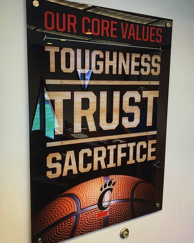 @coachbrannen setting the @gobearcatsbasketball program core values into place in his office... excited to see how the guys buy in! Thanks for choosing Corbitt Graphics! #ucmensbasketball #gobearcats #toughness #trust #sacrifice #corbittgraphics #acrylic