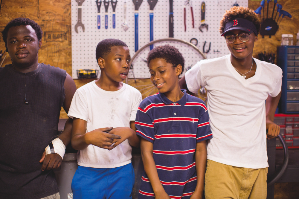 ABOVE: Jquare Smith, 16, Justin Carter, 13, Tremain Gary, 11, and Jadin Lewis, 15, hang out at the shop on Saturdays.