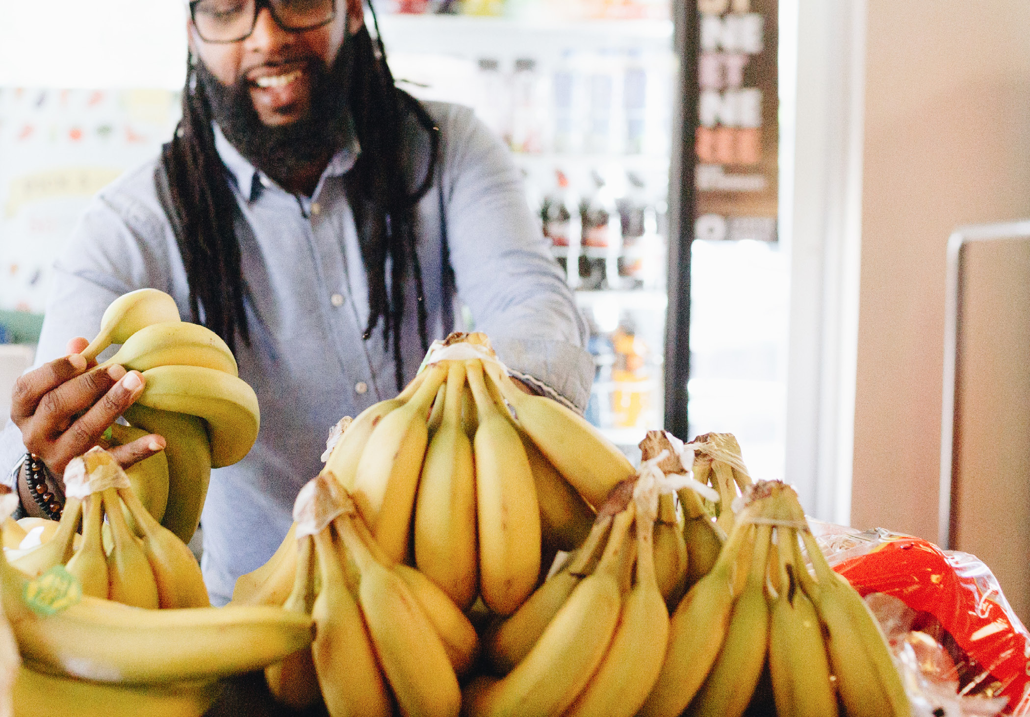 OPPOSITE TOP  Donell Woodson   of Focused Community Strategies shops for bananas in the fresh produce section of Carver Market in South Atlanta.