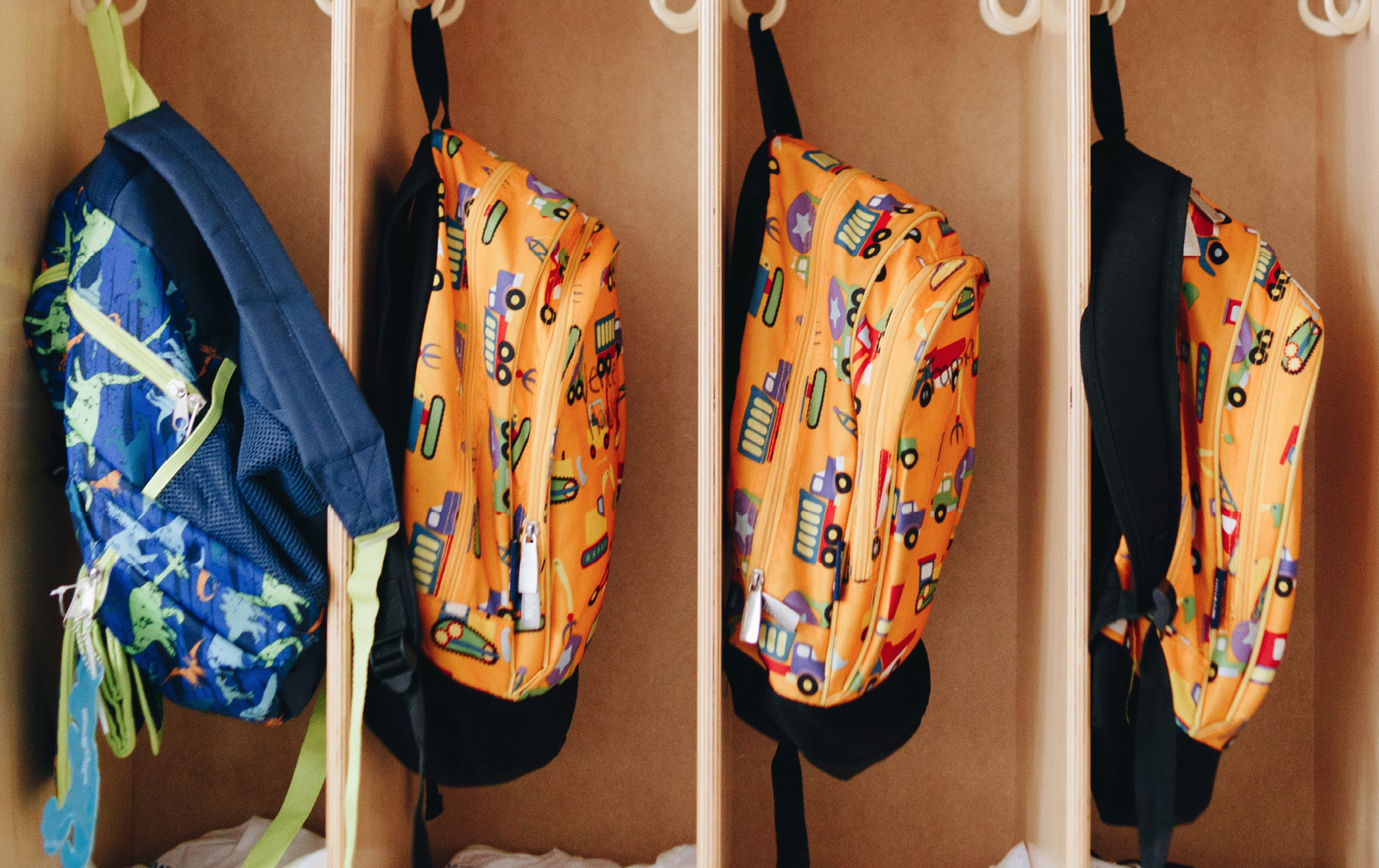 The book bags that hang in students' cubbies were donated at the start of the school year, along with uniforms and other school supplies.