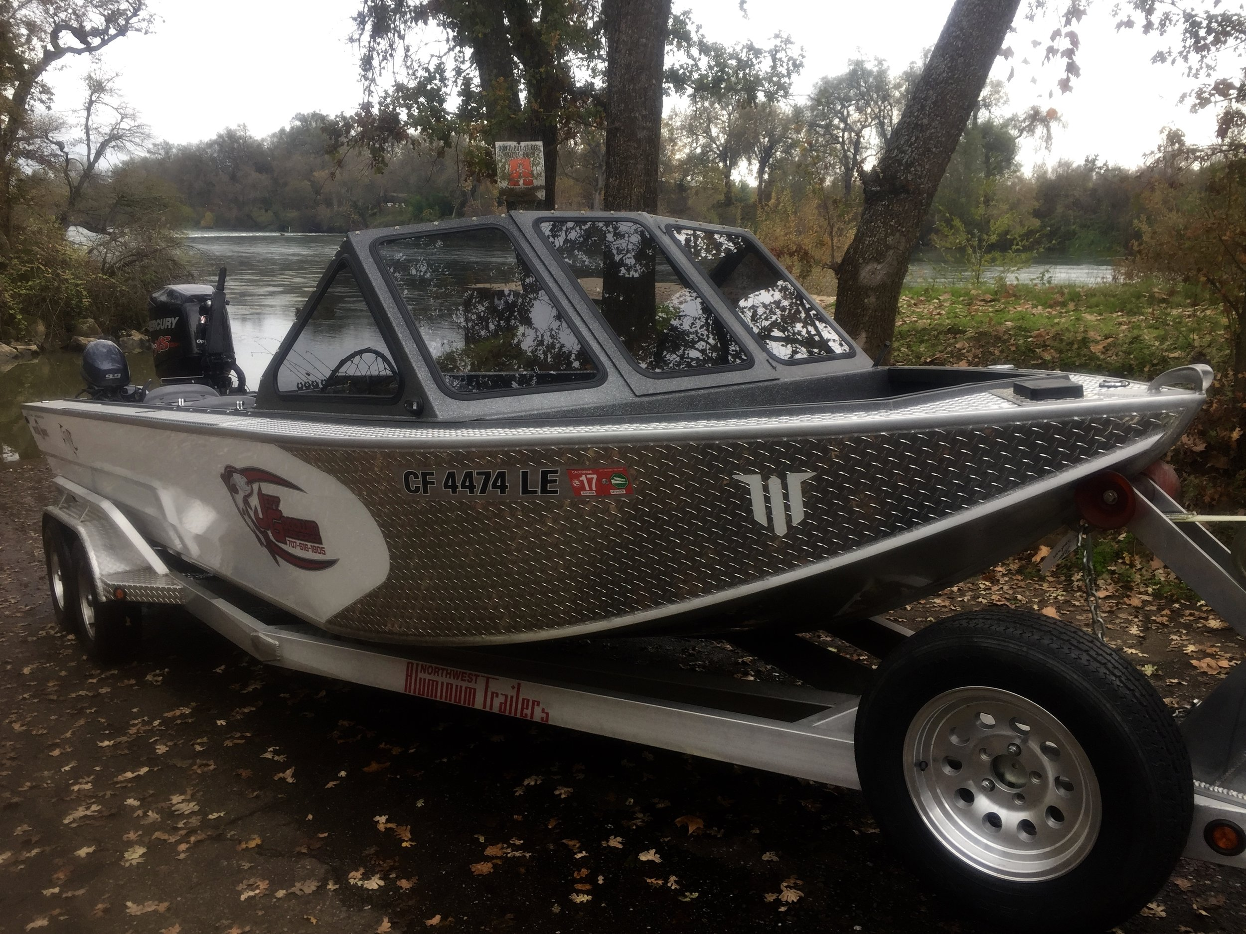Our 2014 Willie Fuzion jet boat pictured with a new removable windshield.