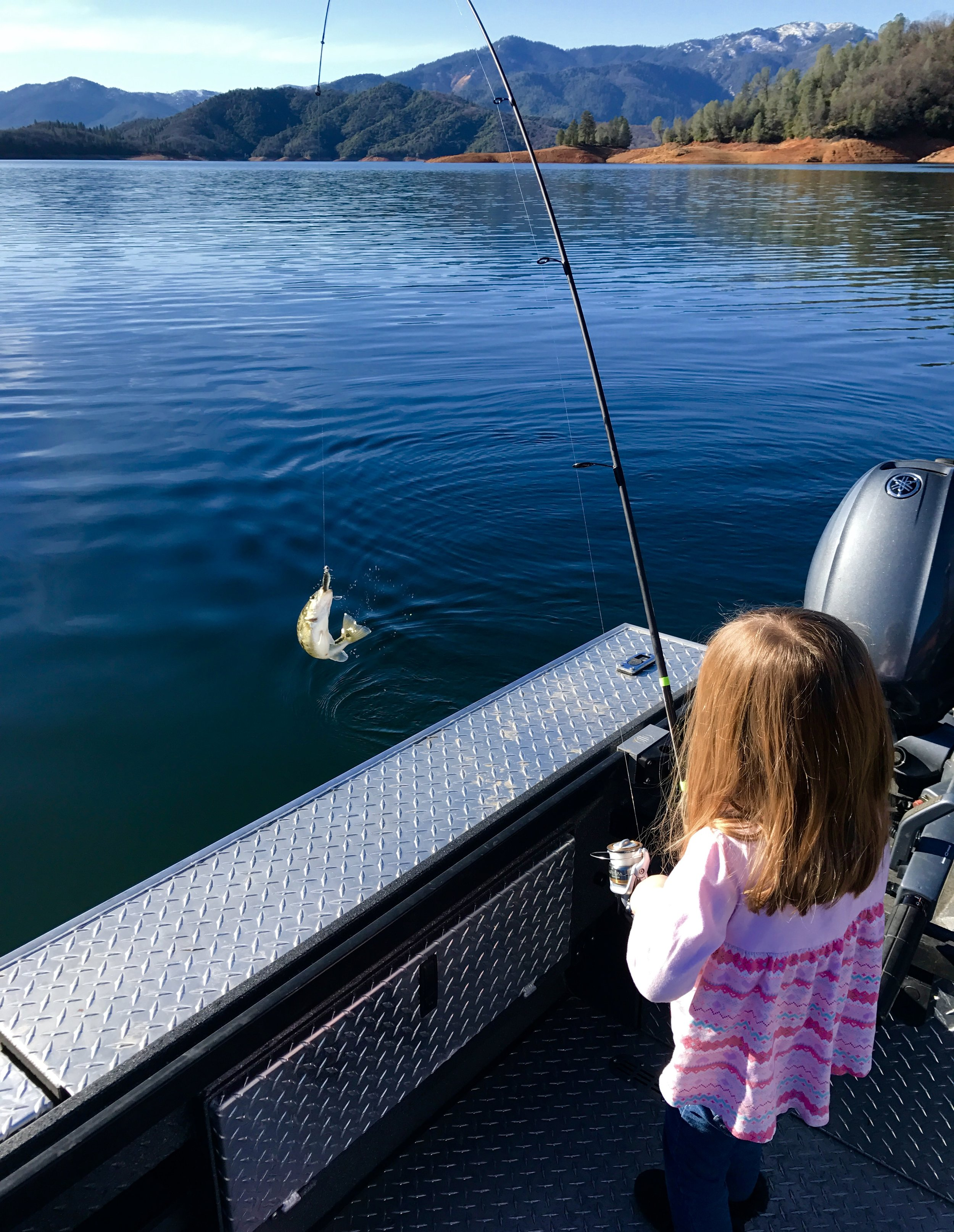 Gracie Goodwin catches a Shasta Lake bass.