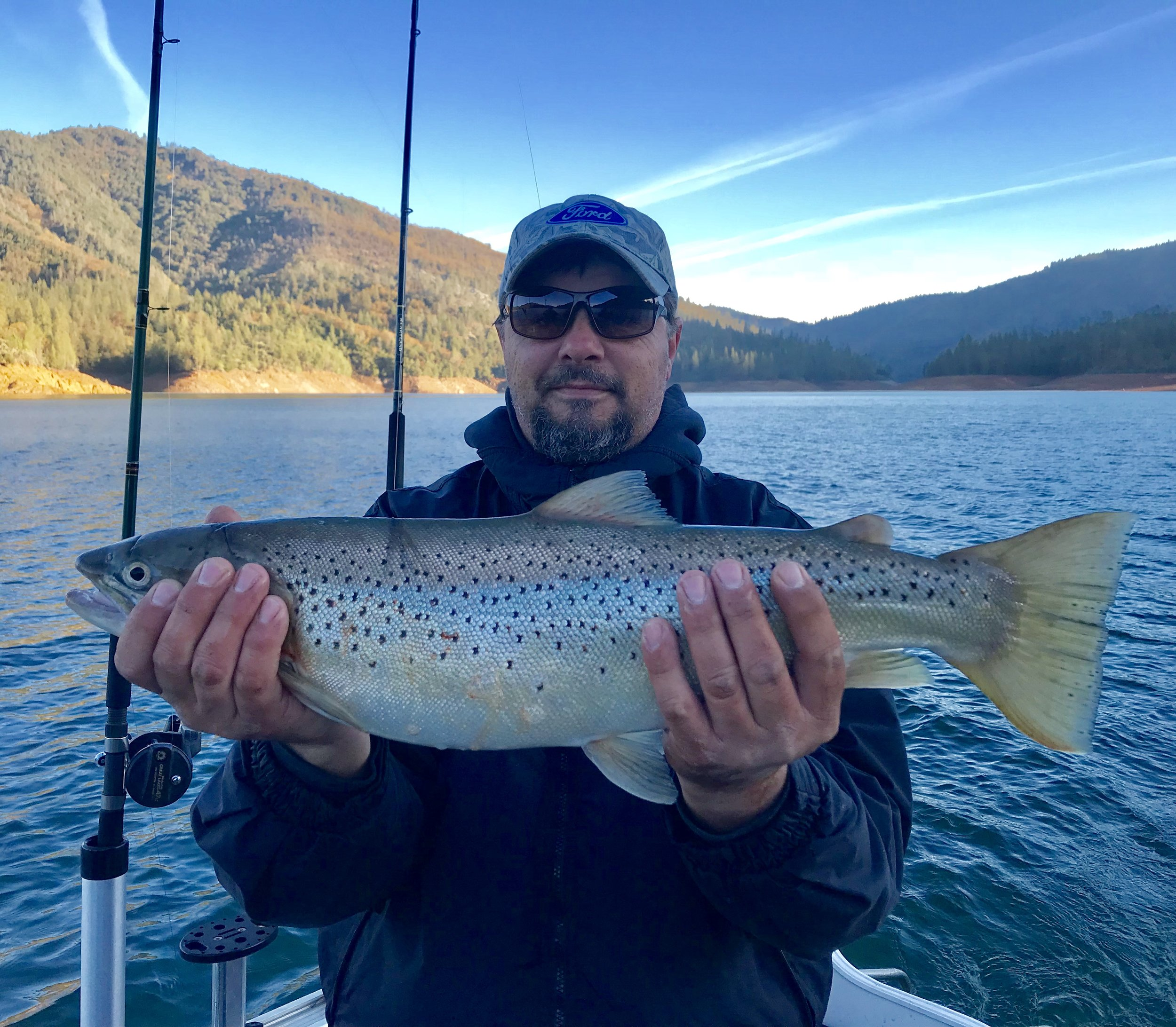 Mike Fisher with a trophy size Shasta Lake German Brown he caught with a Trinidad Tackle #3 1255 Optimizer spoon while fishing with Stan Kulak.