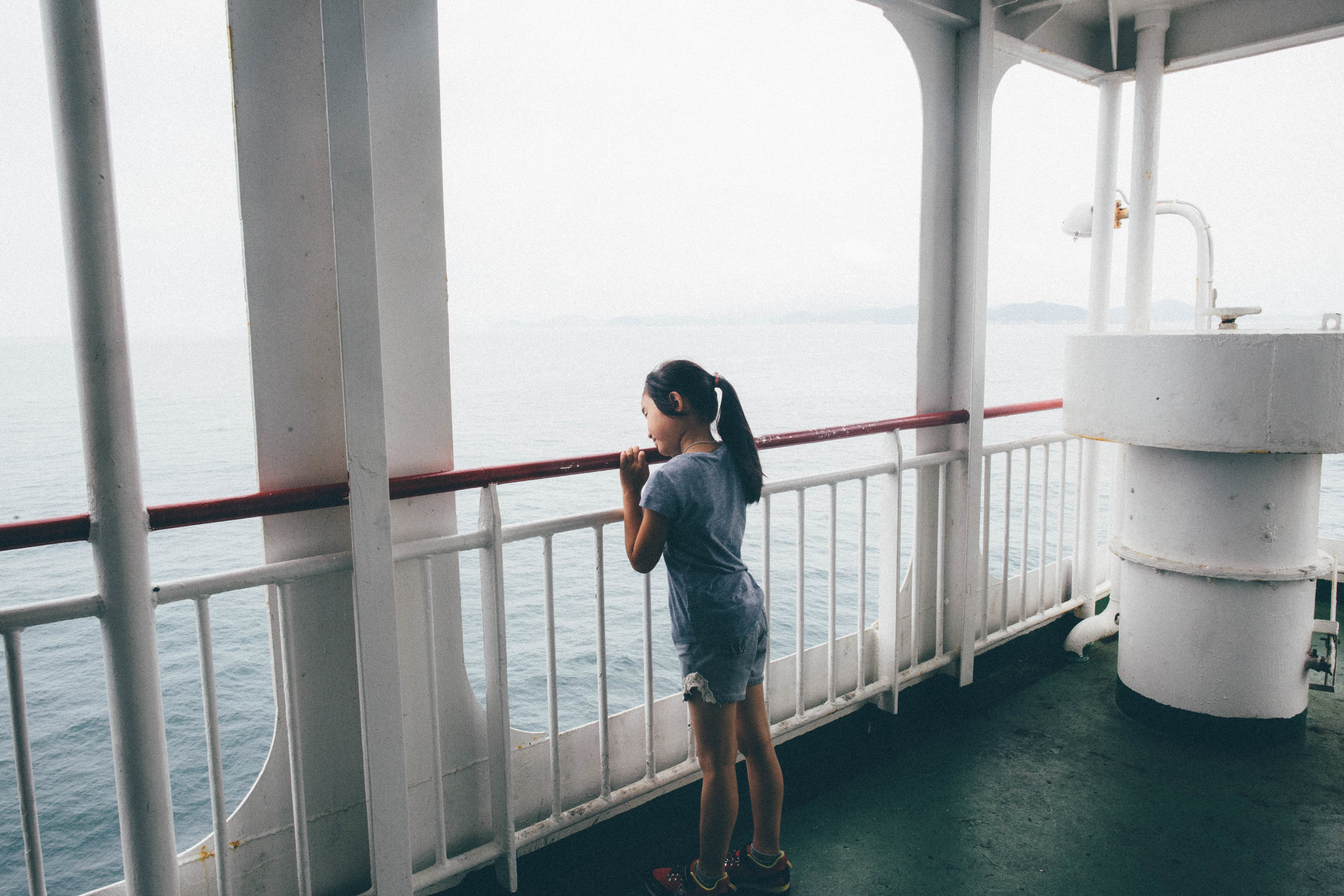 A young girl rides the Hanil Express Ferry to Jeju Island. Jeju-do, South Korea.