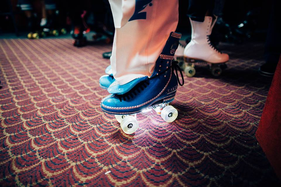 A skater shows off his Intricately designed skates - a typical down South style.