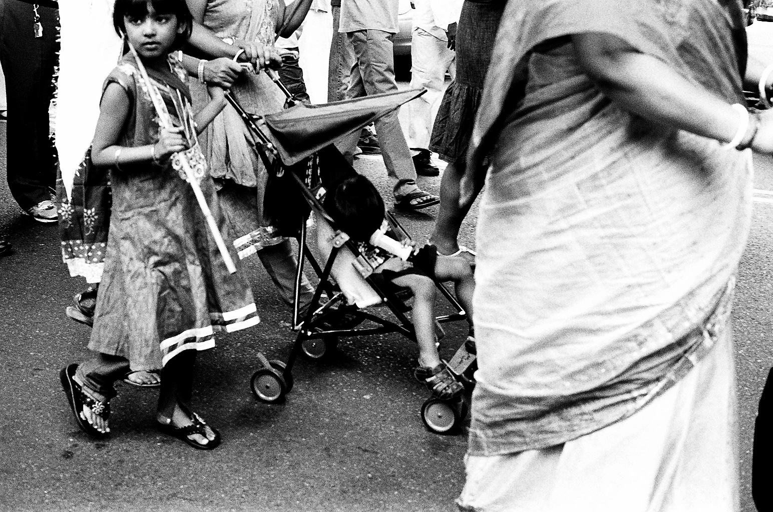 Distracted kids during a Ratha Yatra procession in Richmond Hill