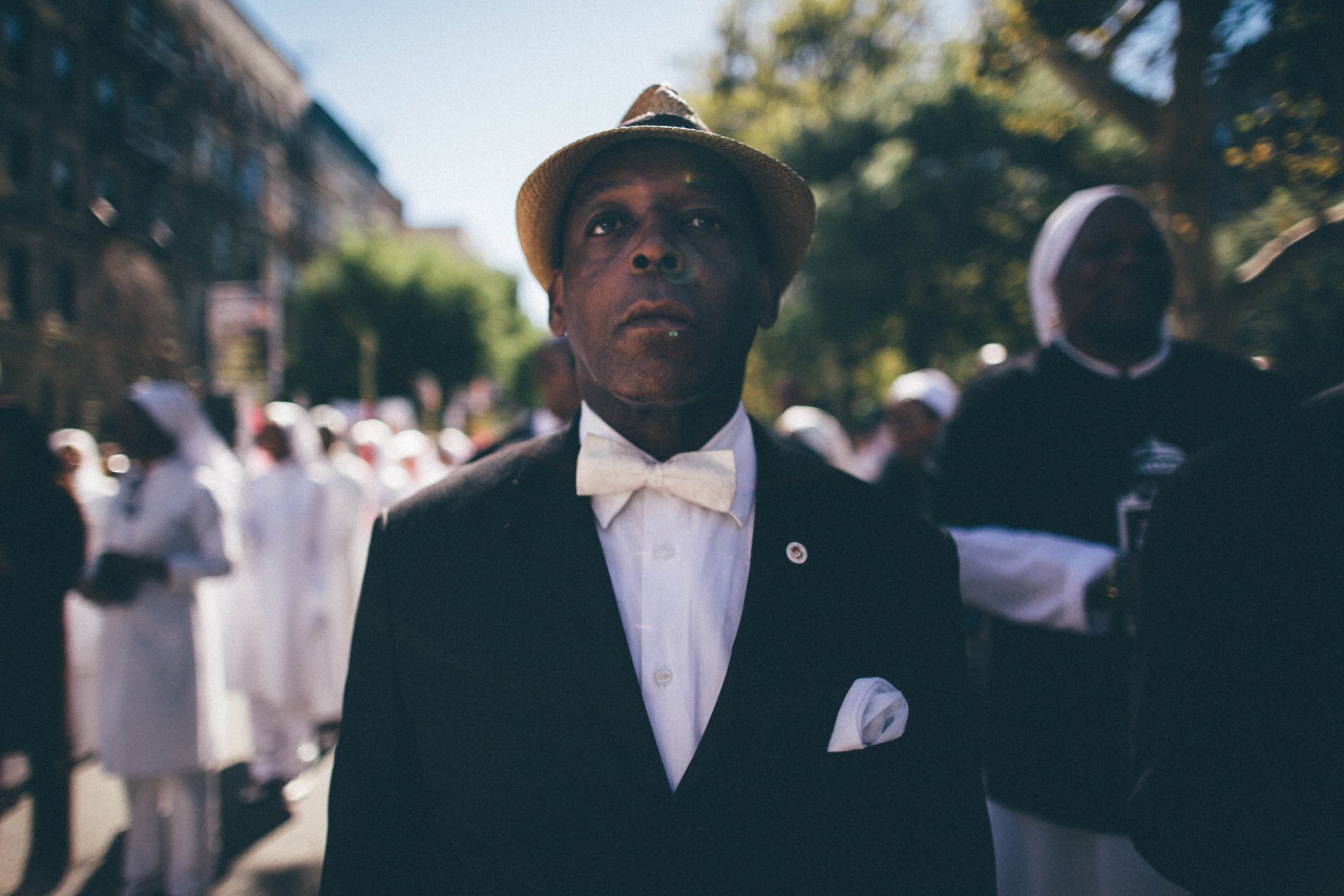 A man from the Nation of Islam prepares to march in the African-American Day Parade. Harlem, New York.
