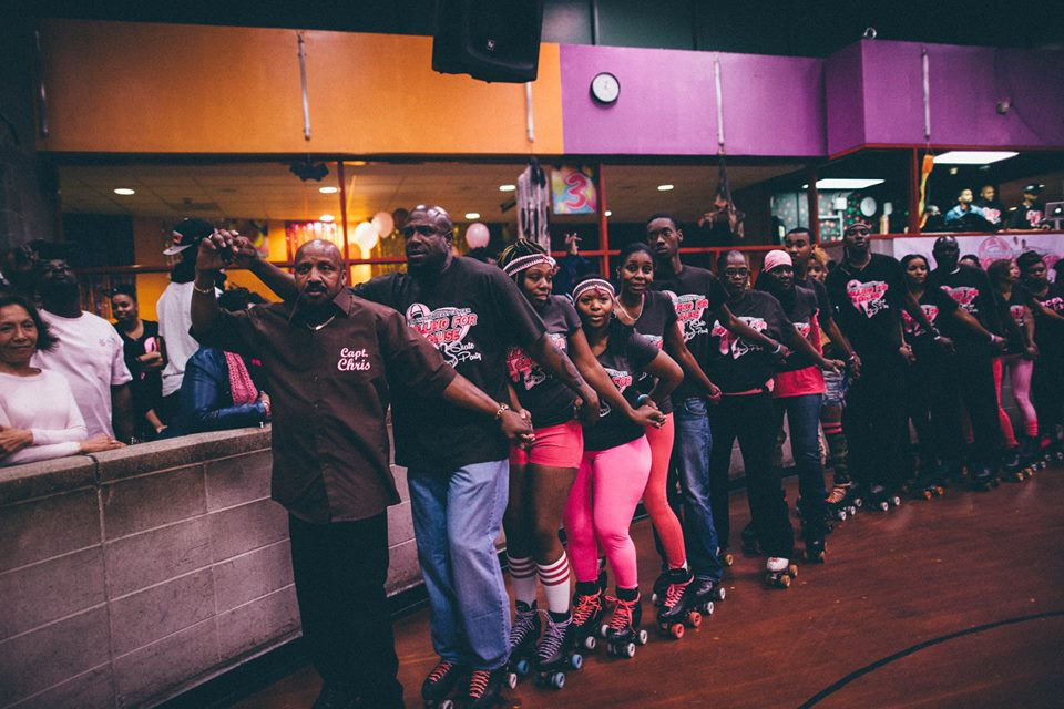 """A """"survivor train"""" at the 8th Annual Rolling for a Cause skate party which raises awareness and funds for cancer. All skaters are encouraged to join this train, which is an event tradition. Branch Brook Park Roller Skating Center. Newark, New Jersey."""
