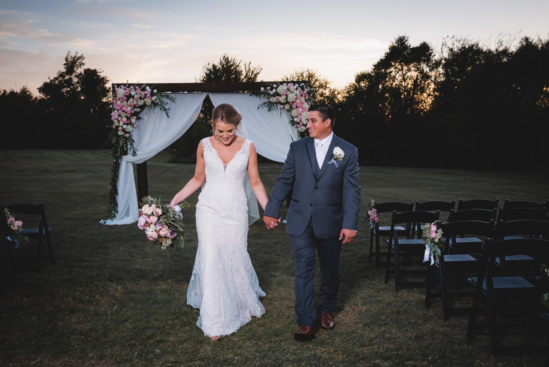 wedding-bride-groom-ceremony-exit-sunset-beautiful-mcgranahan-barn.jpg