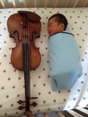 My 5-day-old son next to a 300-year-old Stradivarius...No, he couldn't roll over yet