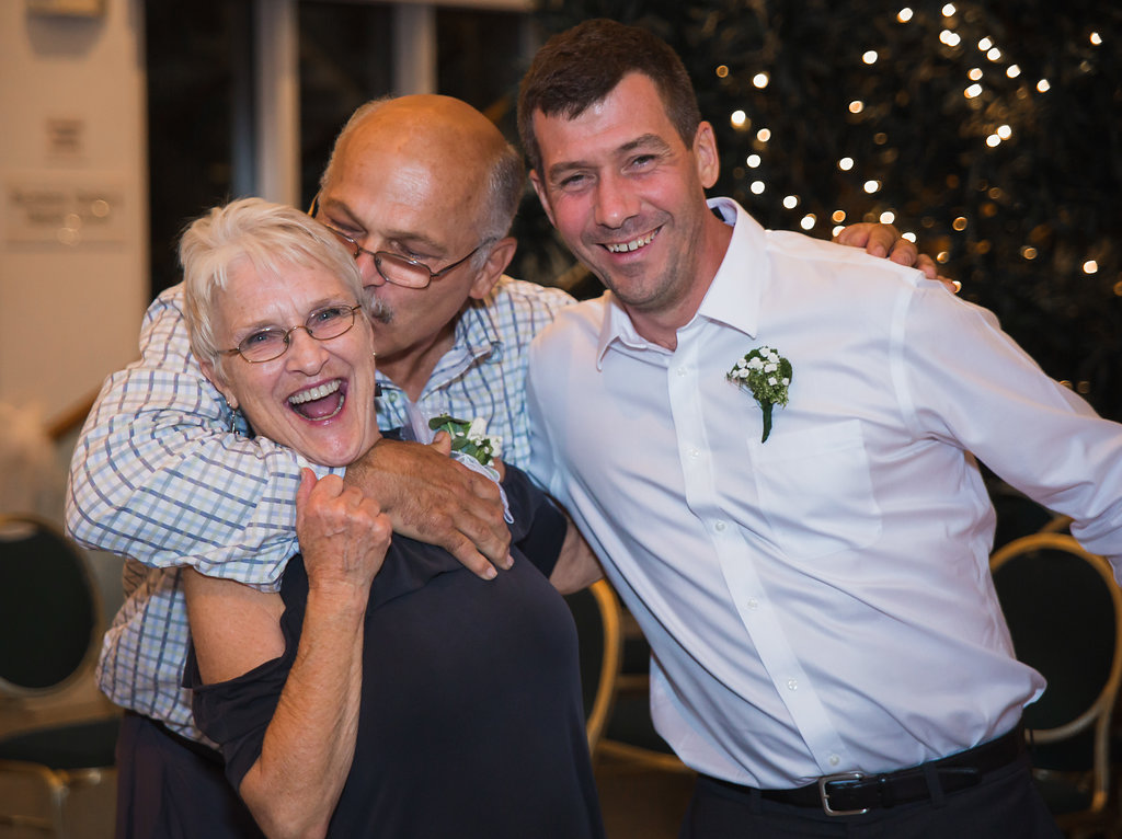 A great candid photo we caught of the mother of the groom getting a loving embrace at the reception! Can't you feel the joy in this photo?