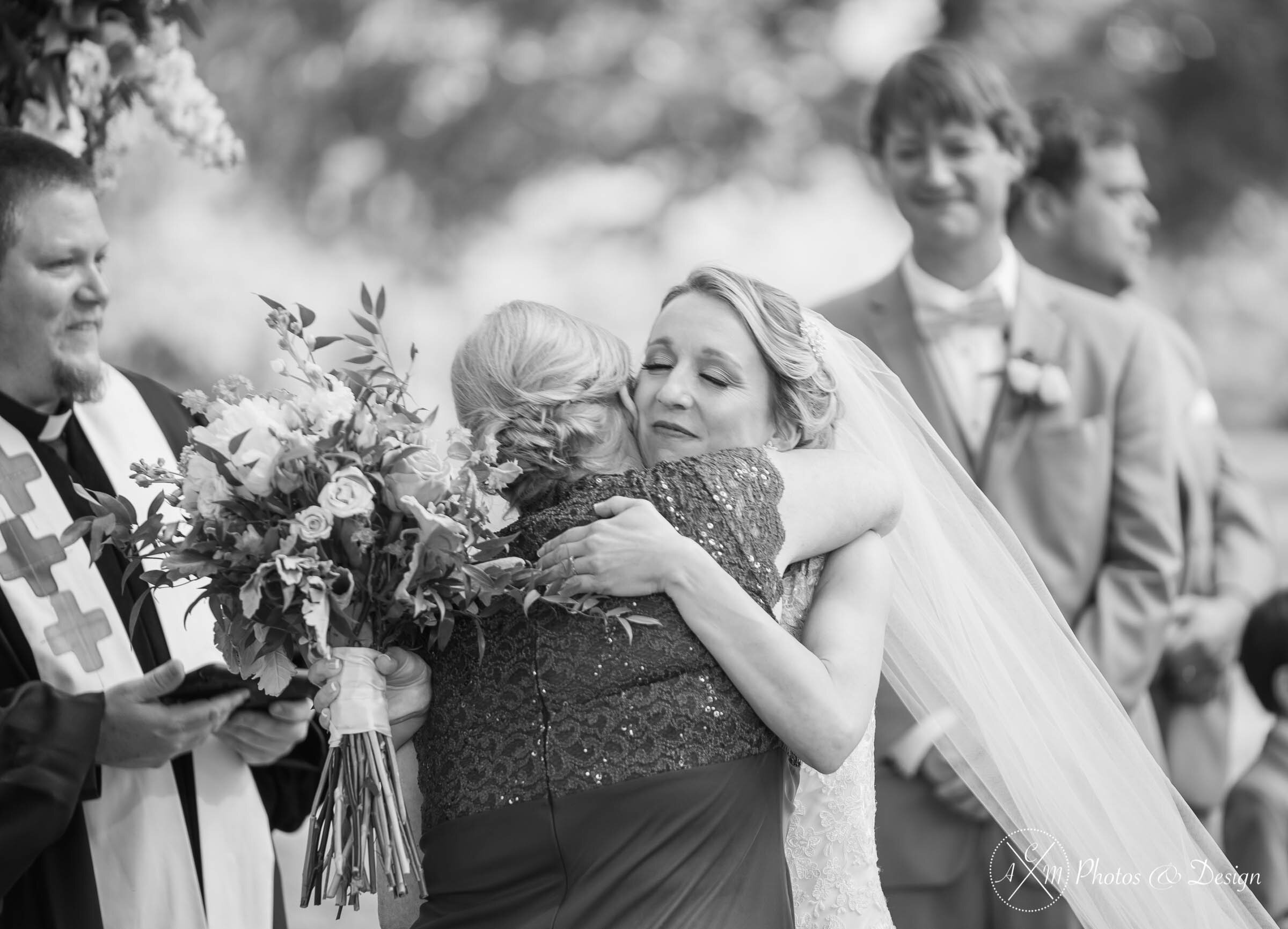 Beautiful moment of one of our bride's and her mom after they walked down the aisle. Utilizing camera settings only, we were able to properly expose this photo while not being too intrusive during the ceremony.