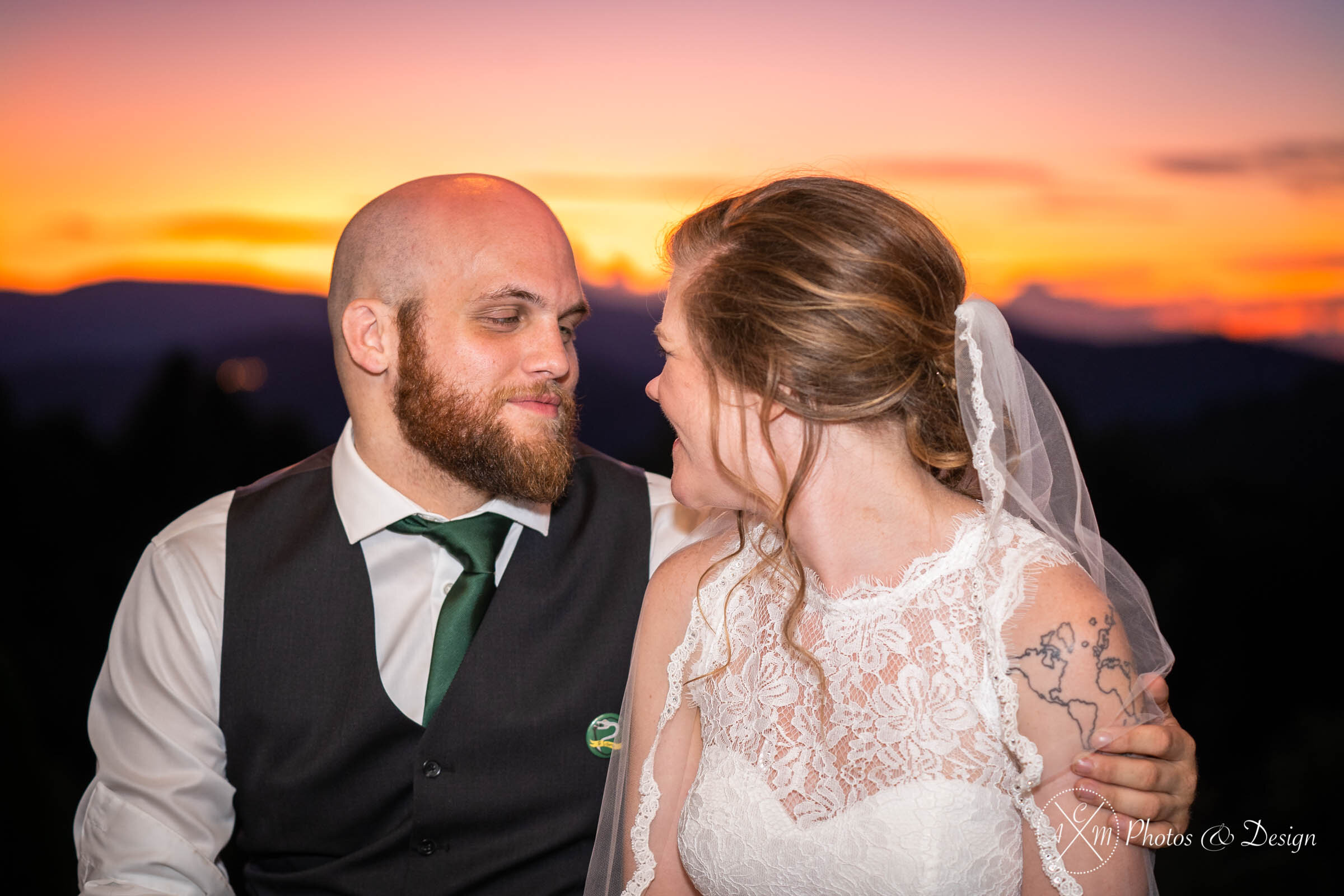 Being able to document that sunset over the mountains and properly expose the bride and groom was very important to us. We grabbed a strobe and captured the bride and groom sitting down and having a moment together after cutting the cake.