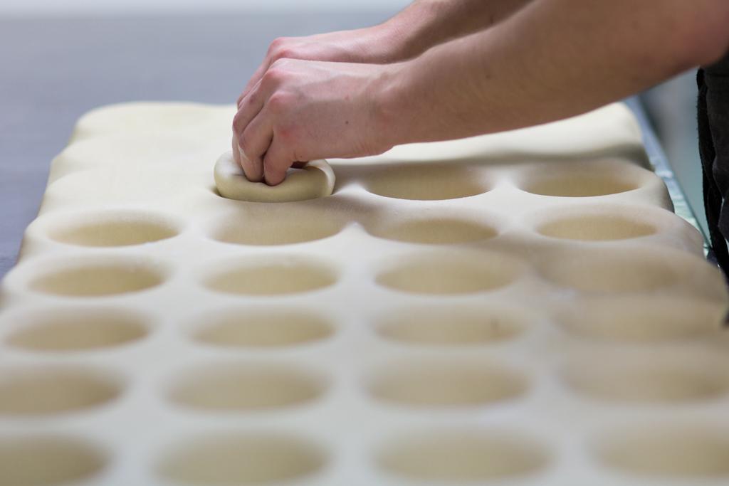 Mapua Village Bakery shaping pie bases.jpg