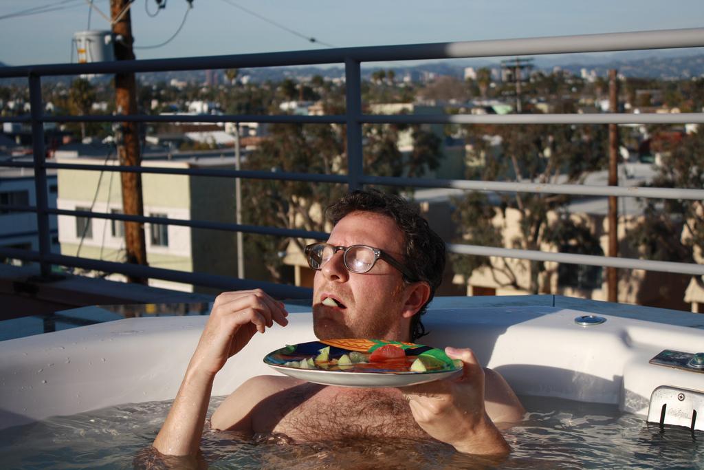 josh roof hot tub eating.jpg