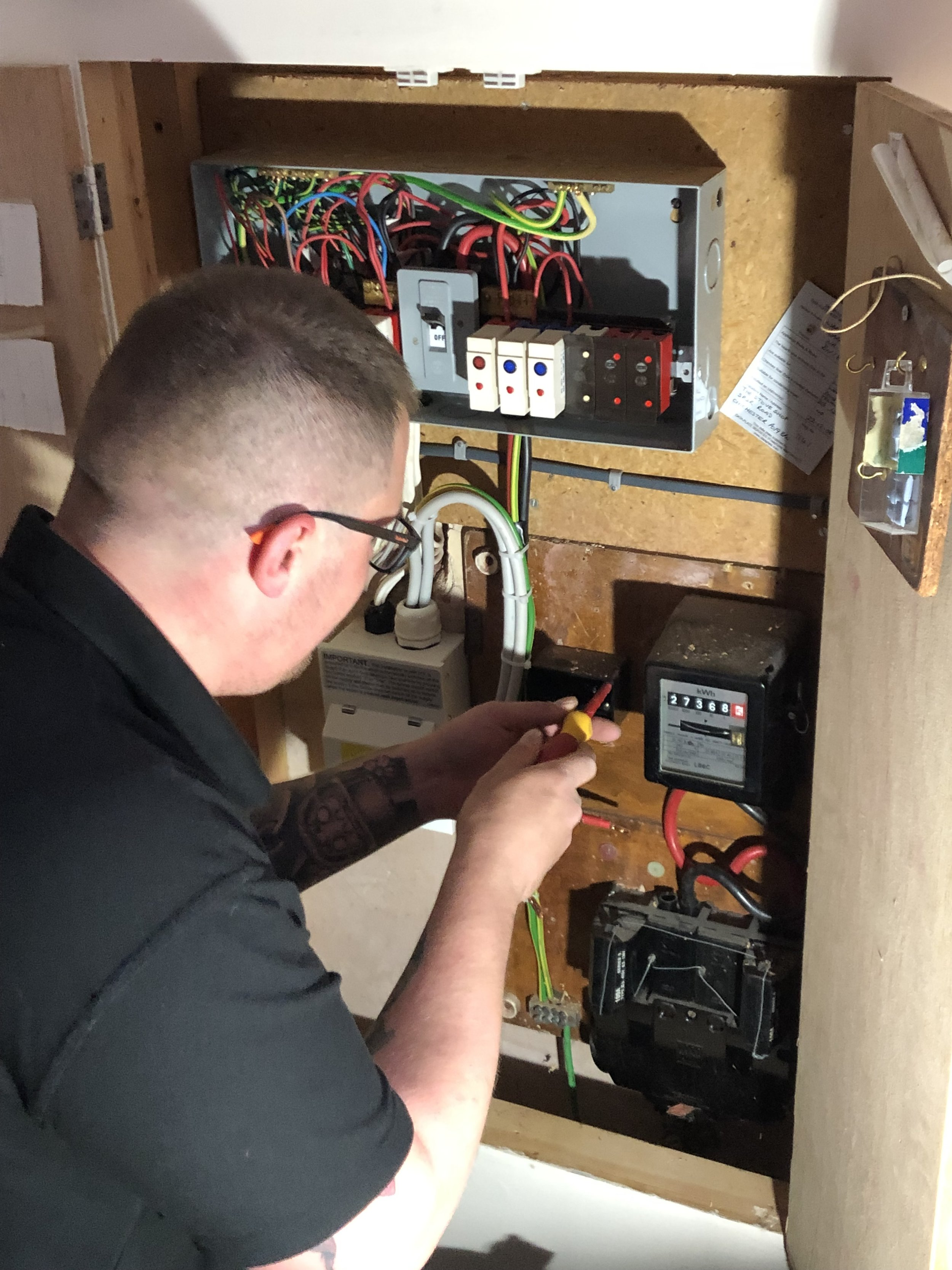 Saul starting to swap over an old fuse board in preparation for a new garage supply, Solar Panels and a Battery Storage System