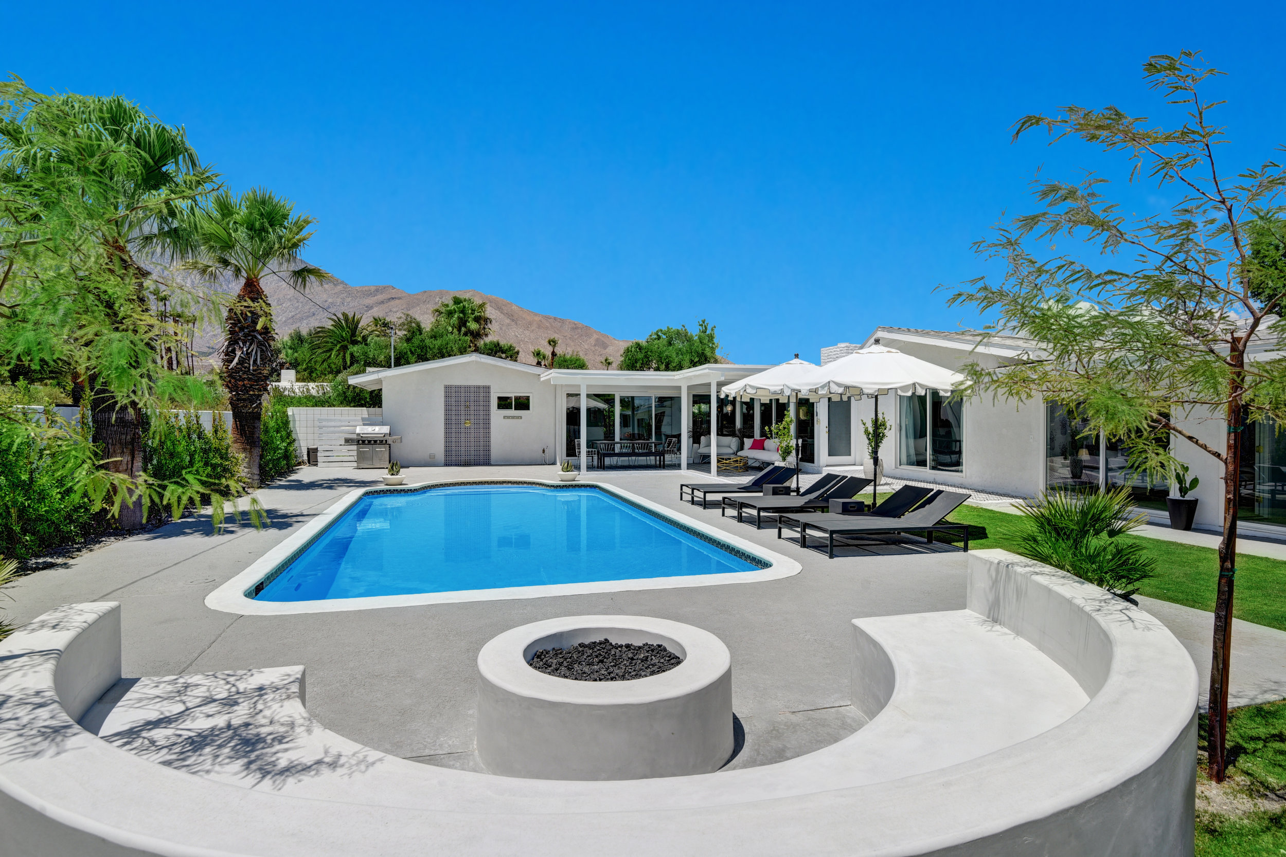 FIRE PIT TO POOL HOUSE AND MOUNTAINS.jpg