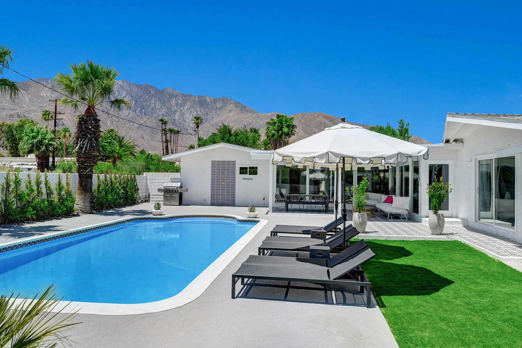 POOL AND CHAISES TO HOUSE AND MOUNTAINS RS.jpg