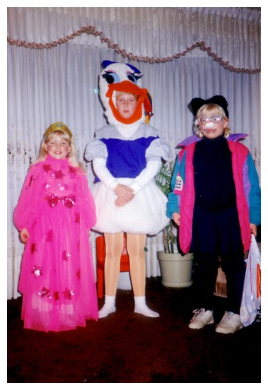 Halloween 1990: a beautiful princess, Donald Duck, and me, an awkward, mulleted cat in sweatpants.
