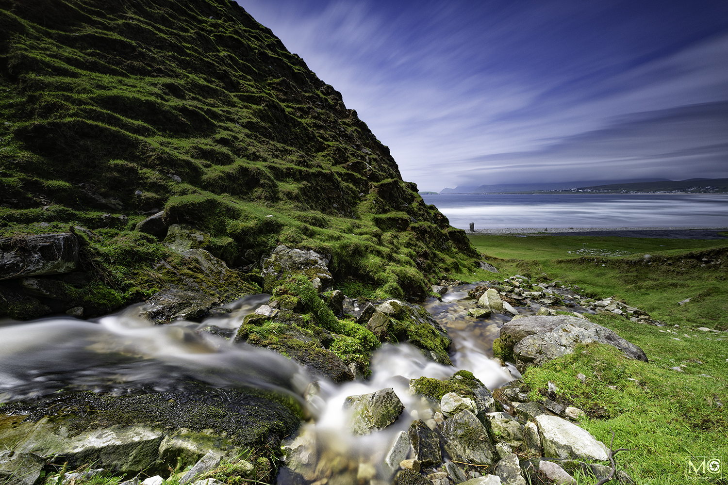River flowing out to sea at Keel Strand, Achill Island, Co. Mayo, Ireland