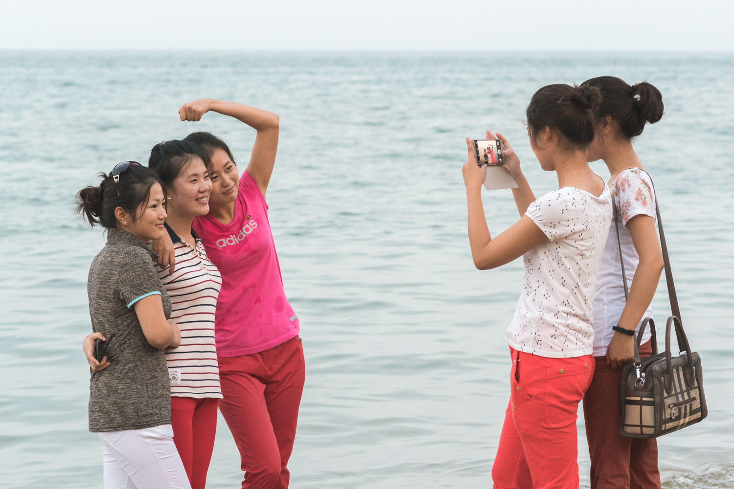 Some of our new students taking photos on the beach.