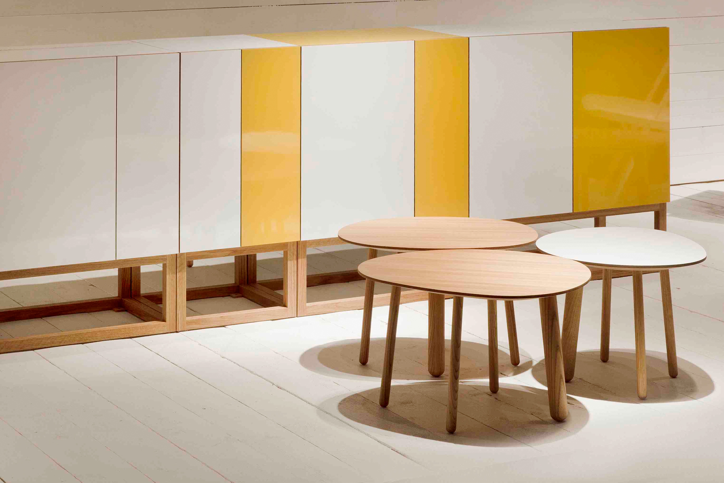 Habitek Stripe cabinet in white and yellow and Morris coffee tables in white and oak