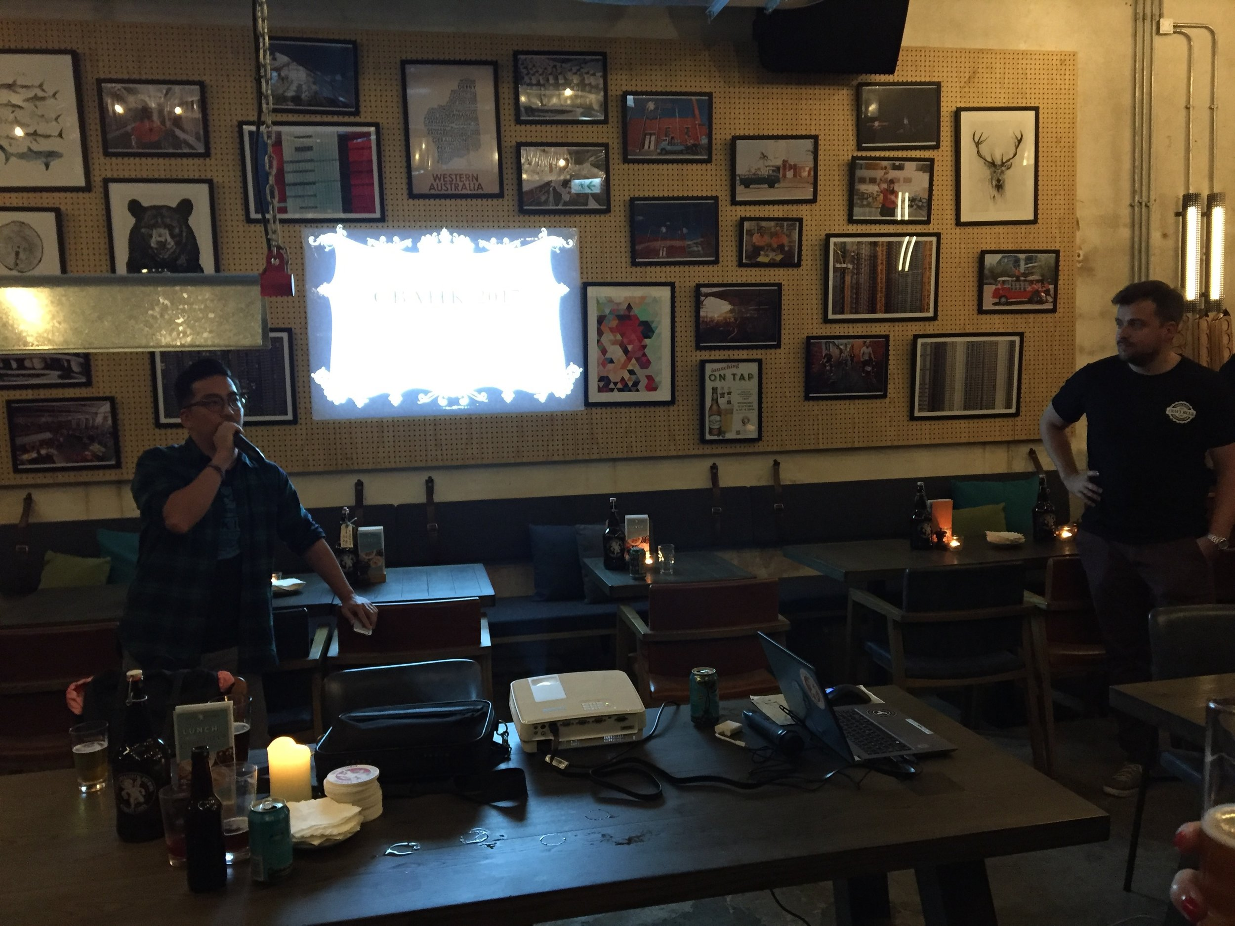 Thomas Lau (left) gives his parting presentation and prepares to announce the newly-elected board at Little Creatures Brewpub in Kennedy Town.