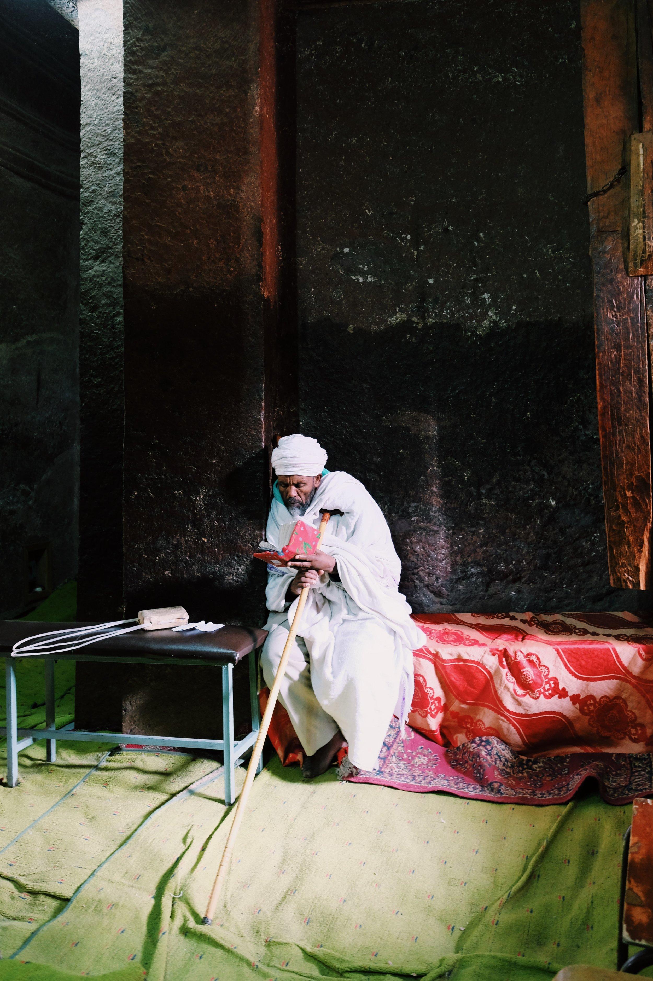 Priest in Lalibela, reading by Joost Bastmeijer.jpeg