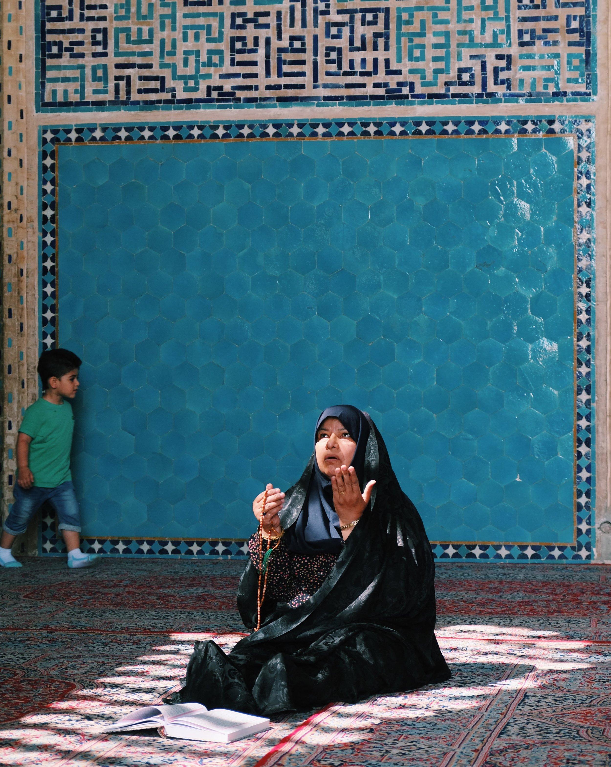 Praying in Yazd Mosque in Iran by Joost Bastmeijer.jpeg