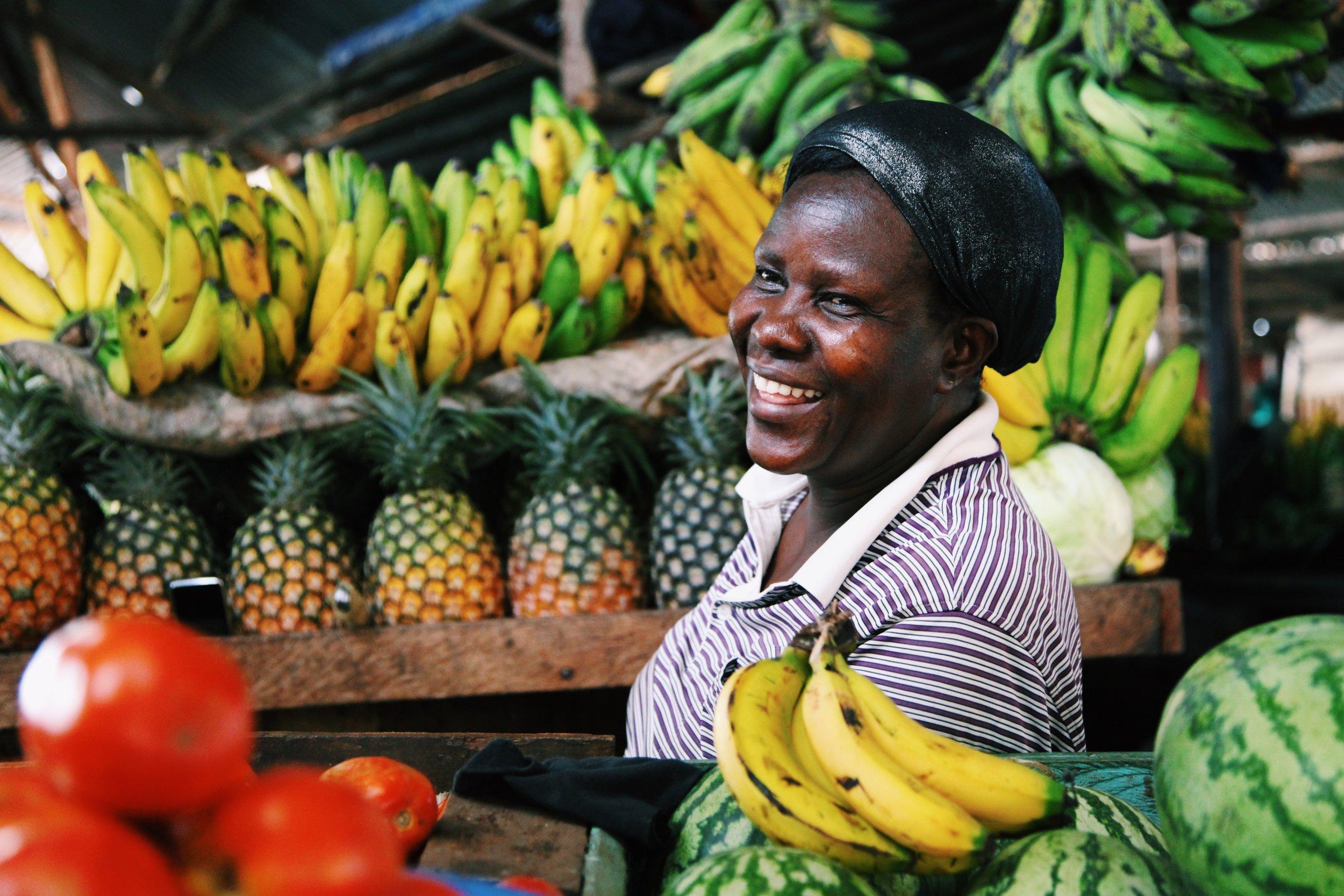 A lady laughs in Entebbe Kotido Market  by Joost Bastmeijer.JPG