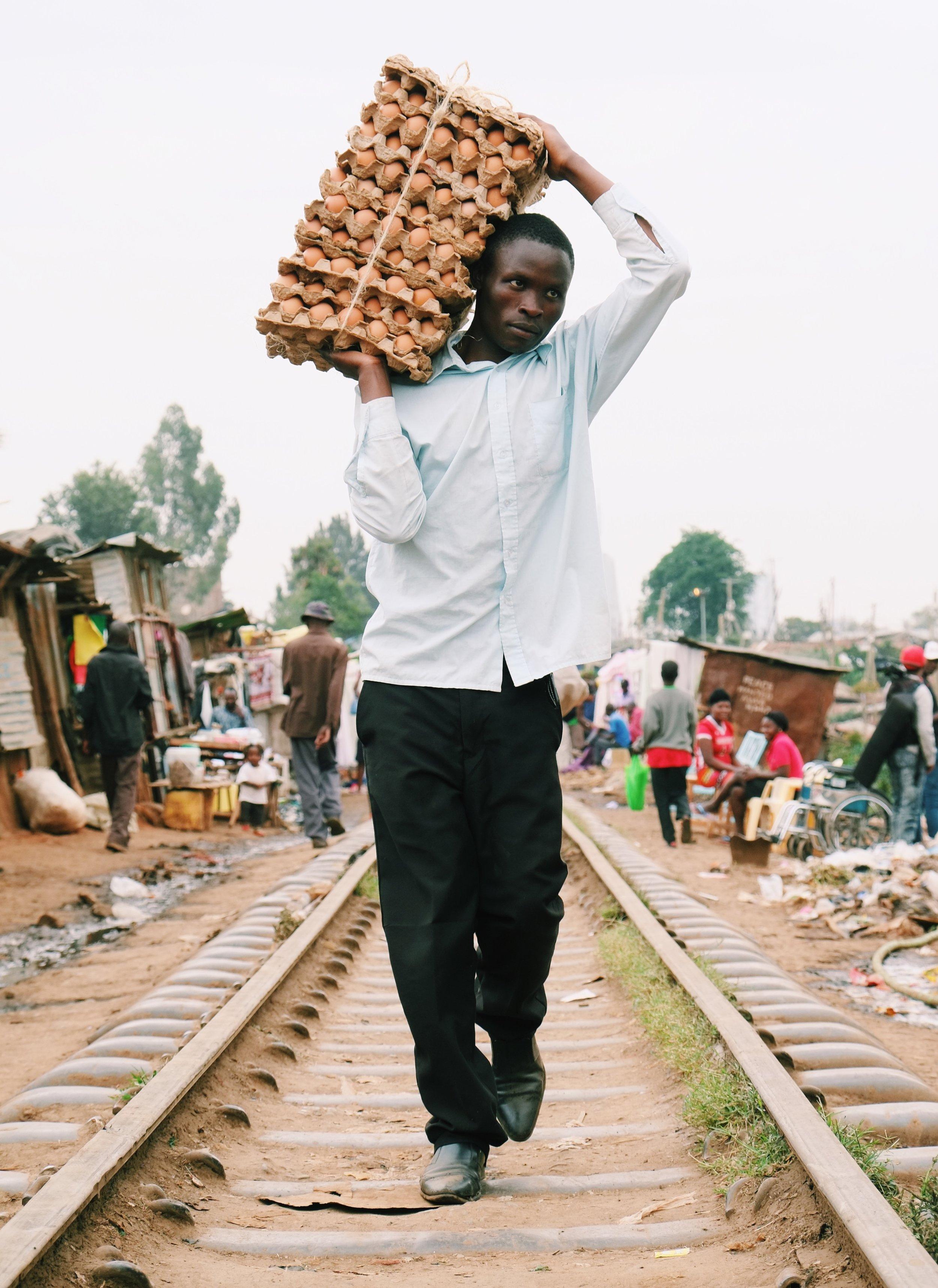 A man carries eggs in Kibera, Kenya.jpeg