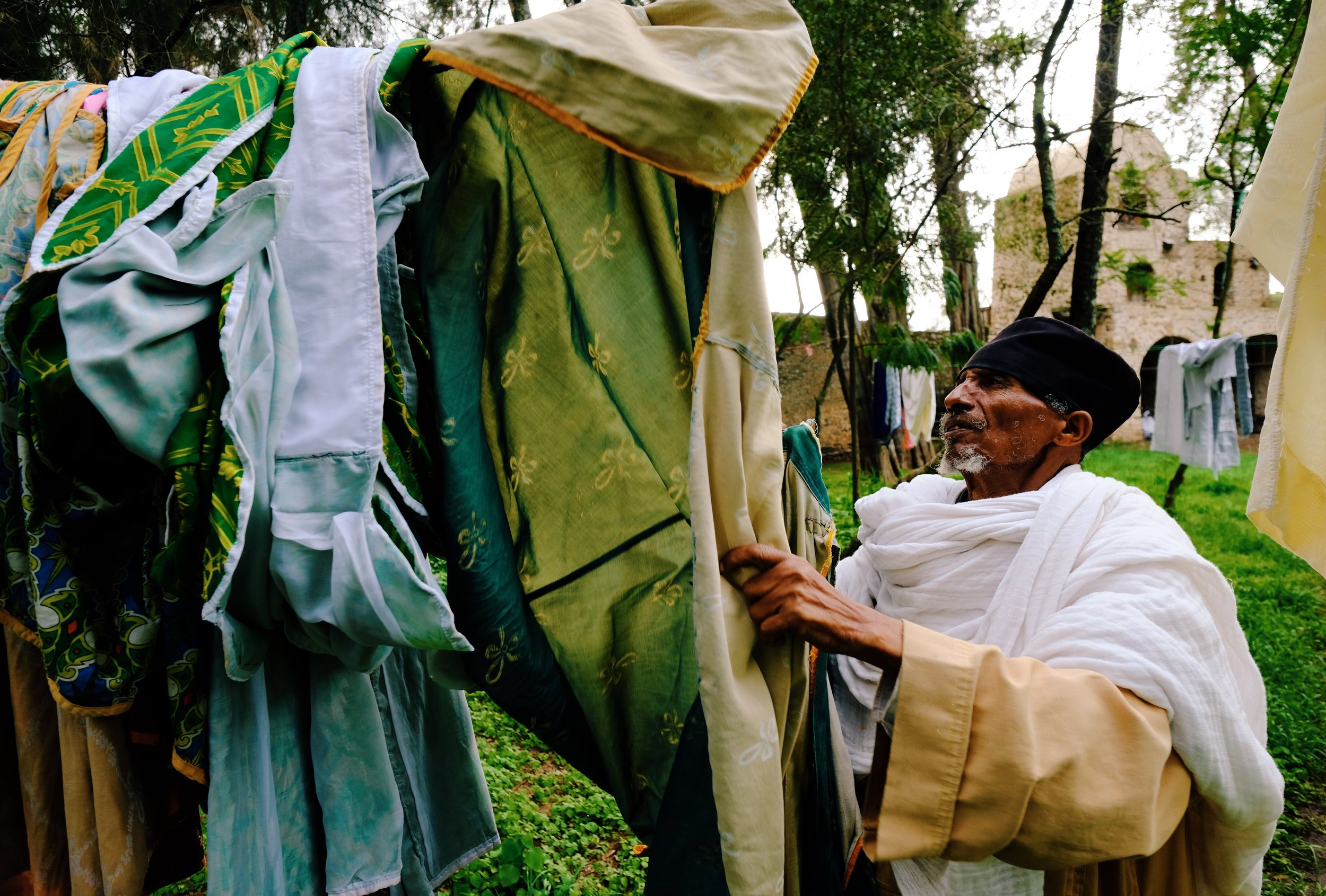 Monk+hanging+laundry+in+Gondar,+Ethiopia+by+Joost+Bastmeijer.jpeg