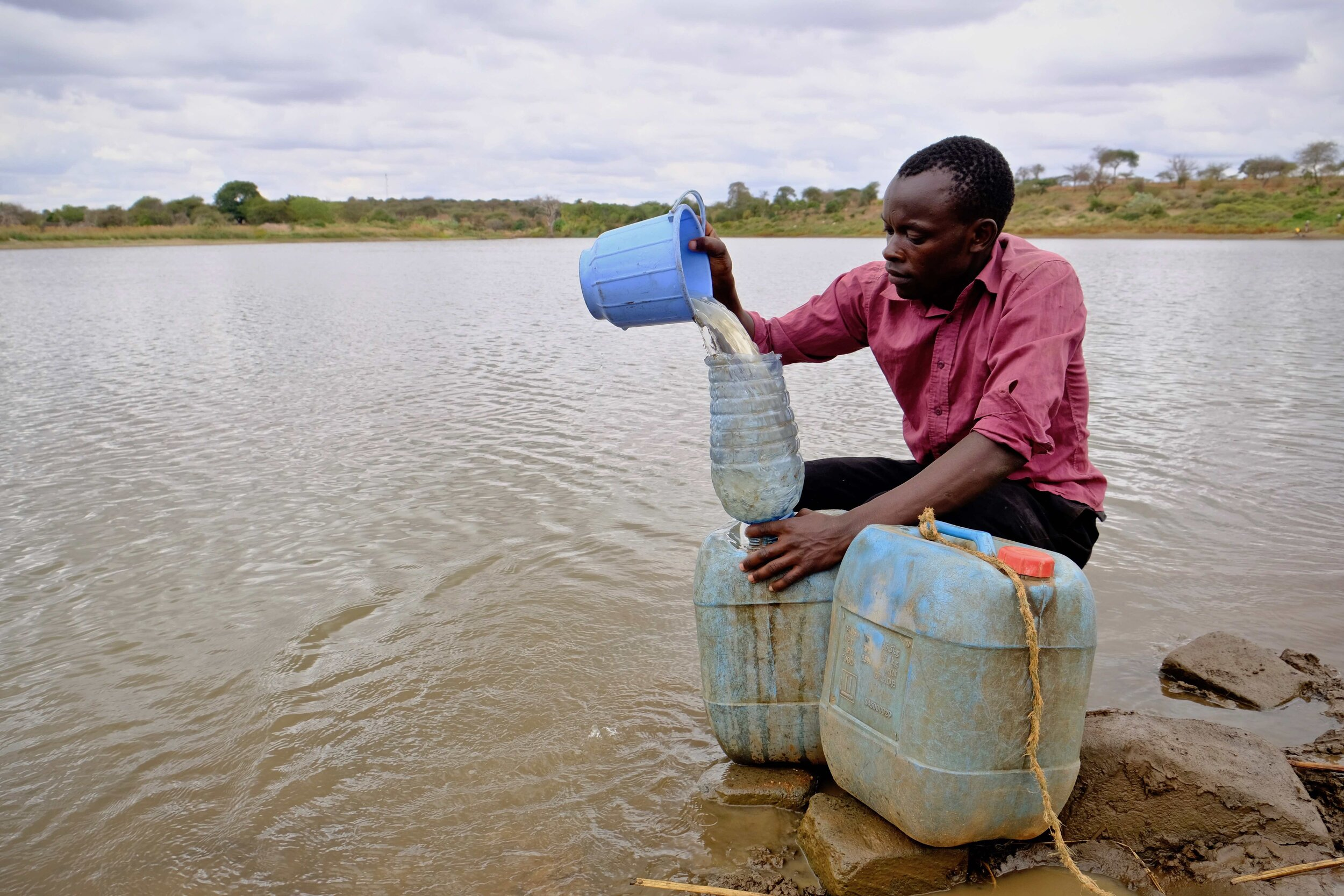 A man fetches water from a dam lake in Makueni County - by Joost Bastmeijer.jpg