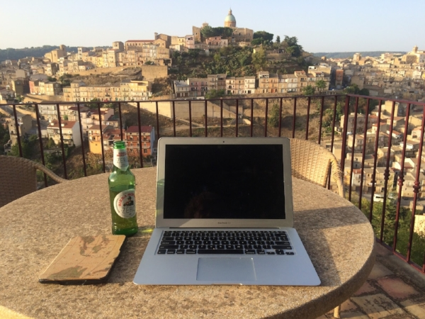 Getting a little work done at our B&B in Piazza Amerina.