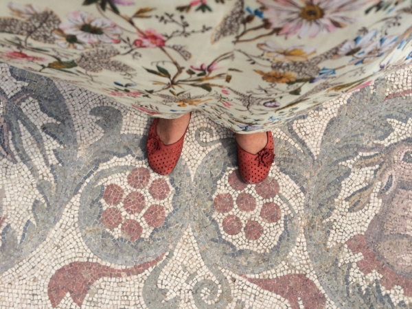 I'm standing on a mosaic floor created 2,000 years ago in    Villa Romana del Casale    .