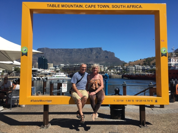 Enjoying the sun and the waterfront with Table Mountain framed behind us.