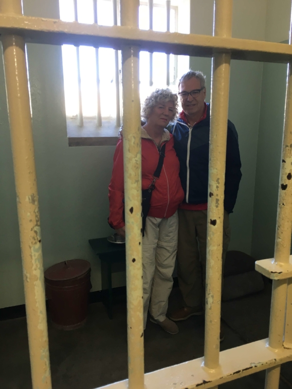 Michael and I getting a dose of reality as we stood inside Mandela's Robben Island cell where he spent 18 of his 27 years in prison. He slept on a thin mat on the floor his head touched one wall and his feet the other.