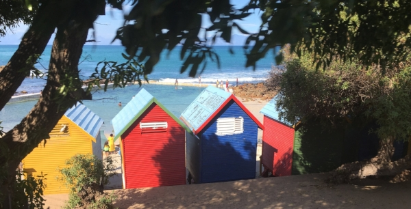 Colorful changing cabins at the saltwater pool on the beach between St. James and Kalk Bay