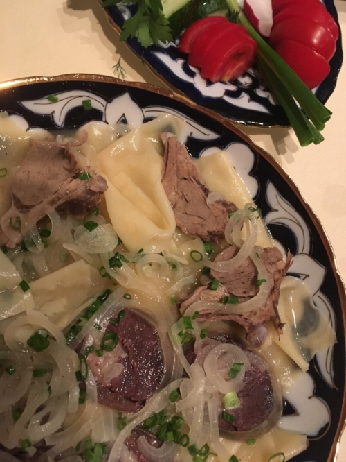Debbie is always ready to try the local cuisine. This dish is soft noodles, horse meat and mystery sausage. She liked it...but wouldn't necessarily have it again.