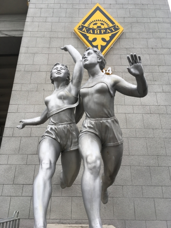 The statues outside the stadium built in the 50's featured woman athletes. But during the track and field event, the male medal winners got large cash prizes. The women got flowers. What?