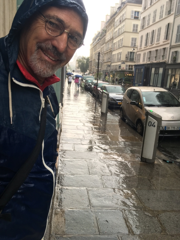 A rainy afternoons in Paris. This time on a walking tour with Michael tucked into a doorway.