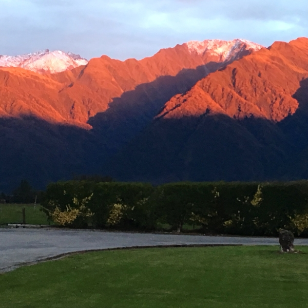 The sunset dazzled the majestic peaks just beyond our motel in Whataroa.