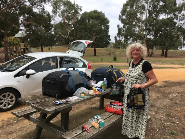 "We took a lunch break on our way back to Melbourne. It was an opportunity to eat any food we still had with us and then repack and reweigh our bags to be sure we met the 25-kilo weight limit. Notice Michael's handy red ""fish scale"" on the bench."