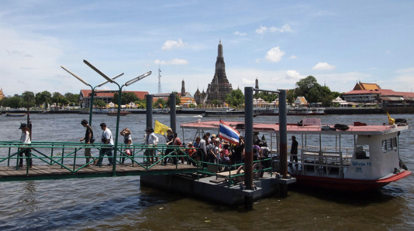 River taxis and ferries of all kinds were plying the waters. We enjoyed hopping on and off as we explored Bangkok.