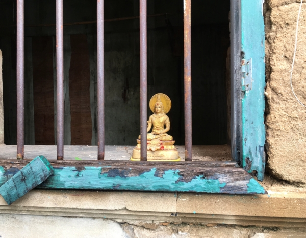 If it weren't for our walking tour, I wouldn't have noticed this precious little Buddha in an abandoned building. It's the small, visual wonders like this that bring a city to life for me.