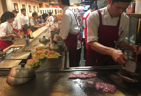 That's my steak being seared a just a foot from my seat - Michael multi-layered omelette is in the background. This was a really fun and affordable way to eat.