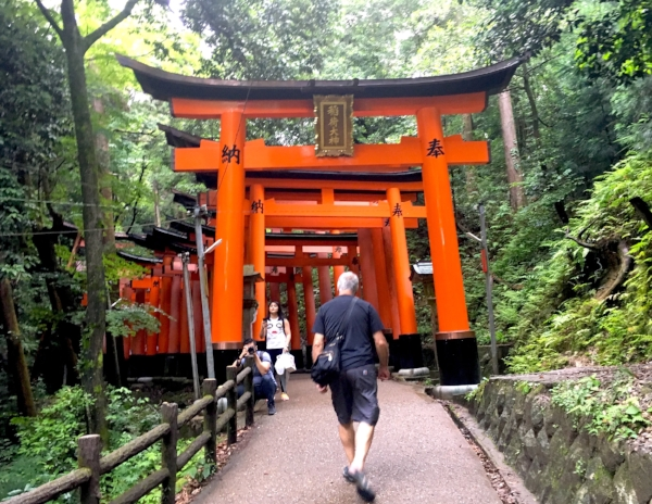 Michael entering the pathway lined with 1,000 Tori Gates at the Fushimi Inari Shrine.